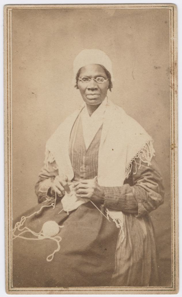 Portrait of abolitionist Sojourner Truth, sitting with yarn and knitting needles