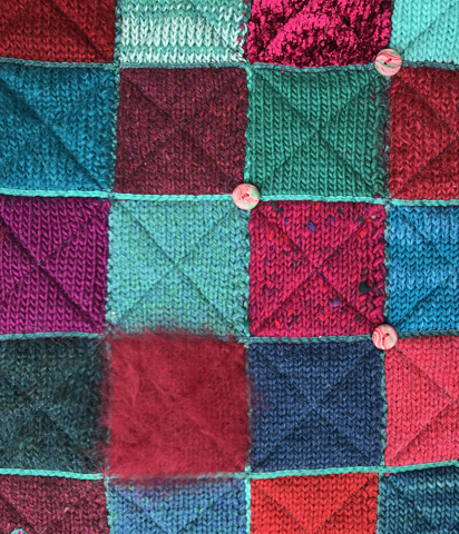 knitted checkerboard, quilted and embellished